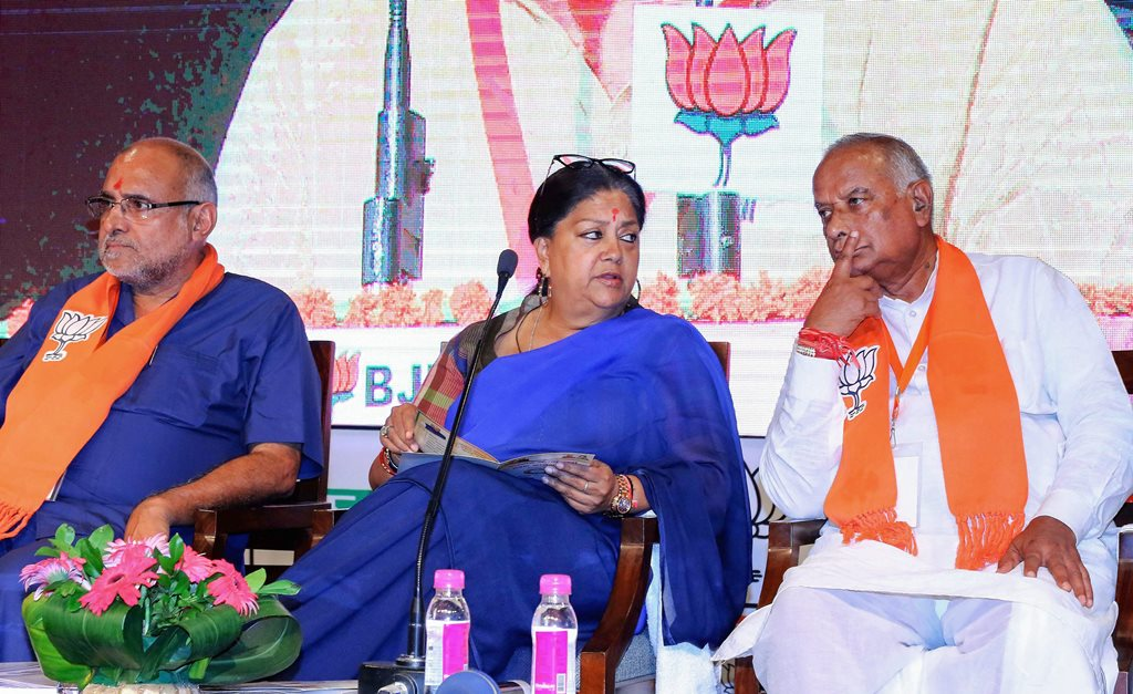 Jaipur: Rajasthan Chief Minister Vasundhara Raje and BJP state President Madanlal Saini attend the two days state working committee meeting, in Jaipur on Friday, July 20, 2018. (PTI Photo)(PTI7_20_2018_000235B)