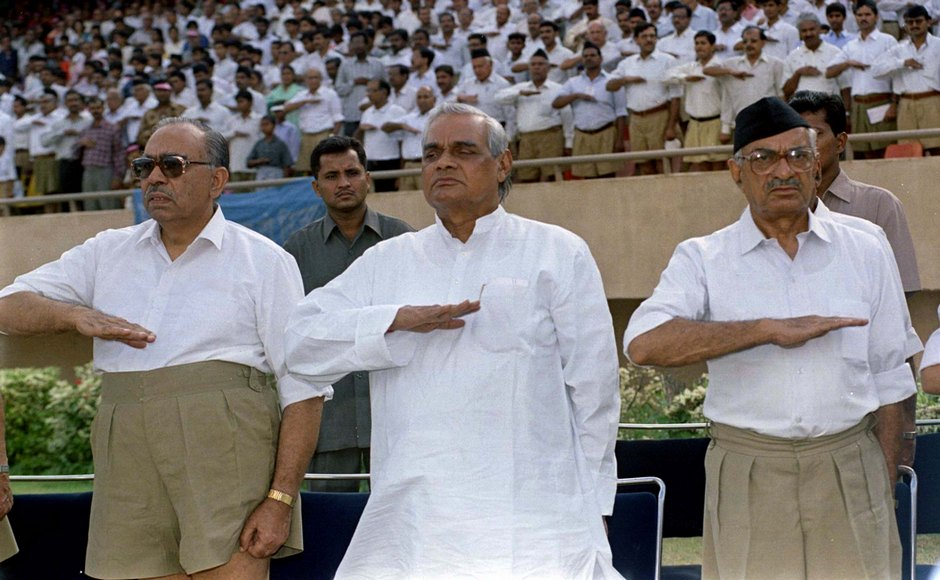Atal Behari Vajpayee (C), prime ministerial candidate of India's Hindu nationalist Bharatiya Janata Party (BJP) salutes with his members at a Rashtriya Swayamsevak Sangh (National Volunteers Organisation) rally in New Delhi. The RSS is a secretive organisation devoted to to remoulding Indian society into a Hindu nation. Picture taken 2OCT97.