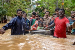 Thiruvananthapuram: Rescuers evacuate people from a flood-hit locality, in Thiruvananthapuram on Wednesday, Aug 15, 2018. (PTI Photo) (PTI8_15_2018_000288B)