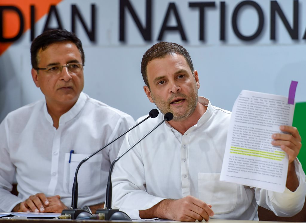 New Delhi: Congress President Rahul Gandhi addresses a press conference in New Delhi on Thursday, August 30, 2018. The party spokesperson Randeep Singh Surjewala is also seen. (PTI Photo/Kamal Singh) (PTI8_30_2018_000228B)