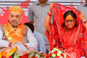 Rajasamand: BJP President Amit Shah with Rajasthan Chief Minister Vasundhara Raje during a public meeting to start 'Suraj Gaurav Yatra' at Rajasamand on Saturday, Aug 4, 2018. (PTI Photo) (PTI8_4_2018_000127B)