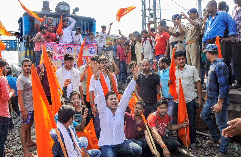 Patna: Swarn Sena activists stop a train during their Bharat bandh, called to press for reservation, in Patna, Thursday, Sept 6, 2018. (PTI Photo) (PTI9_6_2018_000075B)