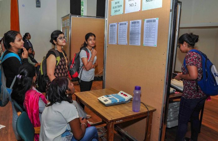 New Delhi: Students wait in a queue to cast their vote during Delhi University elections, in New Delhi, Wednesday, Sept 12, 2018. (PTI Photo) (PTI9_12_2018_000154B)