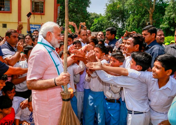 New Delhi: Prime Minister Narendra Modi greets schoolchildren as he undertakes a cleanliness drive under 'Swachhta Hi Sewa' campaign in the premises of Baba Sahib Ambedkar Higher Secondary School at Paharganj, in New Delhi, Saturday, Sept 15, 2018. (PTI Photo) (PTI9_15_2018_000052B)