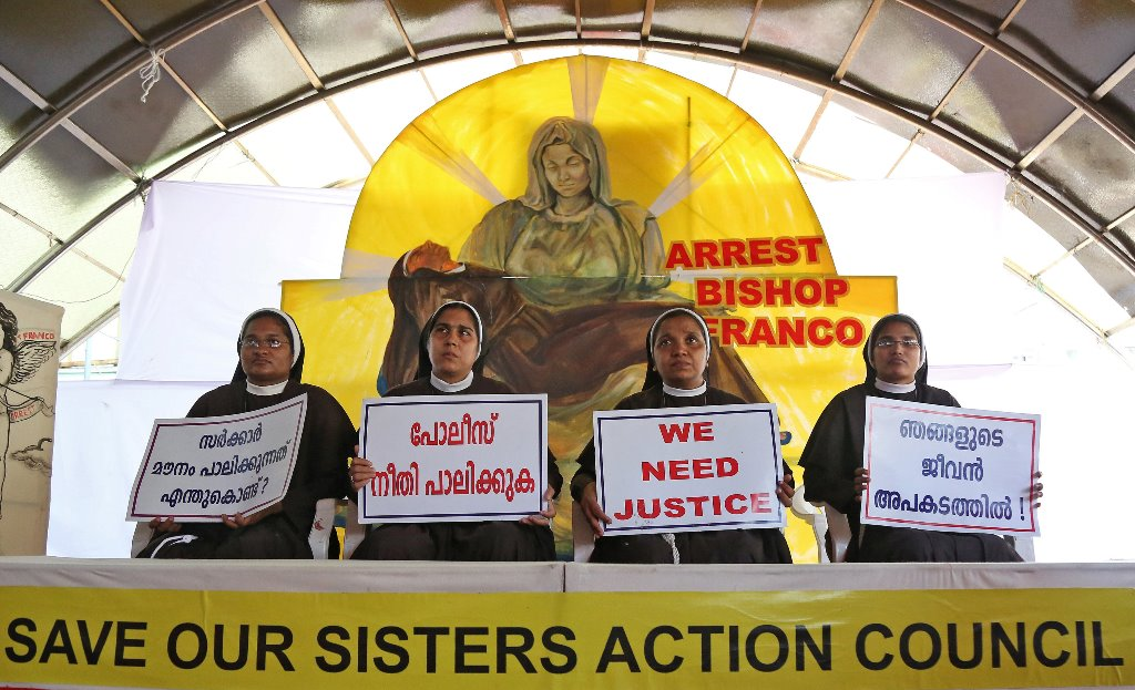 "Nuns hold placards during a protest demanding justice after an alleged sexual assault of a nun by a bishop in Kochi, in the southern state of Kerala, India, September 13, 2018. The placards read in Malayalam ""Why is the government silent?', 'Police, do justice', and ""Our lives are threatened'. REUTERS/Sivaram V"