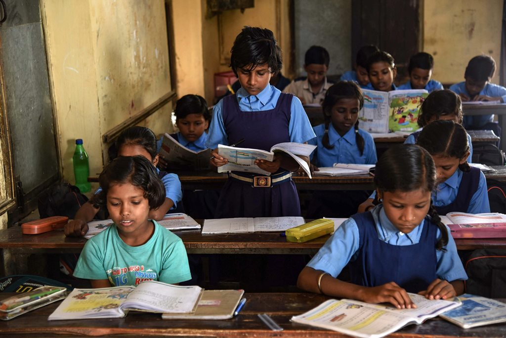 Allahabad: Children attend a class at a Government school on the occasion of 'World Literacy Day', in Allahabad, Saturday, Sept 8, 2018. (PTI Photo) (PTI9_8_2018_000090B)
