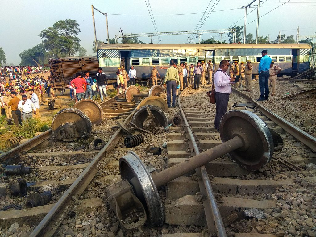 Raebareli: Police at locals at the site of the accident where eight coaches and the engine of the New Farakka Express train derailed near Raebareli, Wednesday, Oct 10, 2018. At least four people were killed in the accident. (PTI Photo) (PTI10_10_2018_000024B)