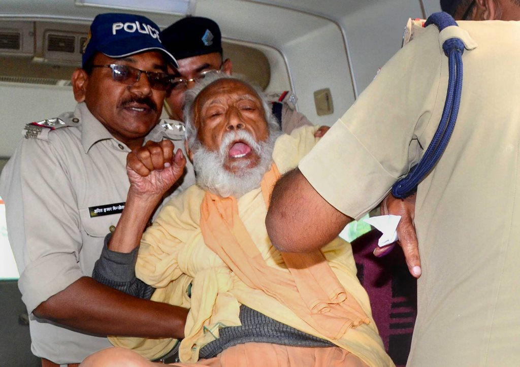 Haridwar: Environmentalist G D Agarwal, who has been fasting for over 100 days for a clean River Ganga, being forcibly taken to the hospital after his health detriorated in Haridwar, Wednesday, Oct 10, 2018. (PTI Photo) (PTI10_10_2018_000143B)