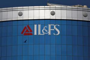 FILE PHOTO: A bird flies next to the logo of IL&FS (Infrastructure Leasing and Financial Services Ltd.) installed on the facade of a building at its headquarters in Mumbai, India, September 25, 2018. REUTERS/Francis Mascarenhas/File photo