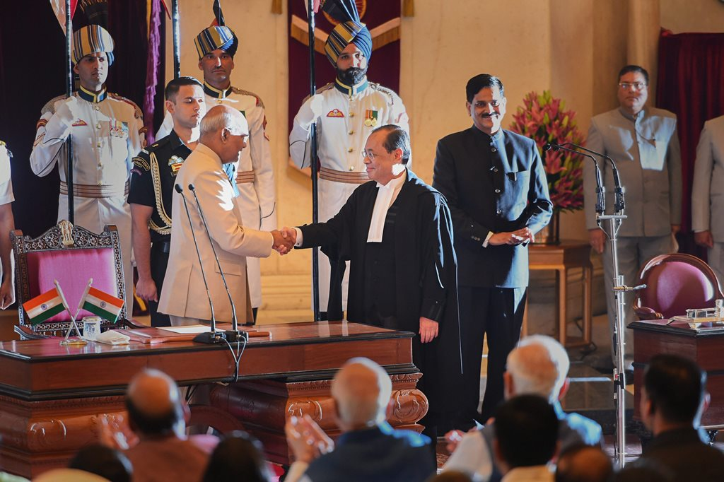 New Delhi: Newly sworn-in Chief Justice of India Justice Ranjan Gogoi shakes hands with President Ram Nath Kovind after he was administered oath of office, at Rashtrapati Bhawan in New Delhi, Wednesday, Oct 3, 2018. (PTI Photo/Shahbaz Khan) (PTI10_3_2018_000026B)