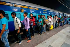 Ahmedabad: Migrant workers prepare to board the Sabarmati Express in view of protests which broke out over an alleged rape of a 14-month-old girl, in Ahmedabad, Monday, October 8, 2018.  (PTI Photo)  (PTI10_8_2018_000158B)