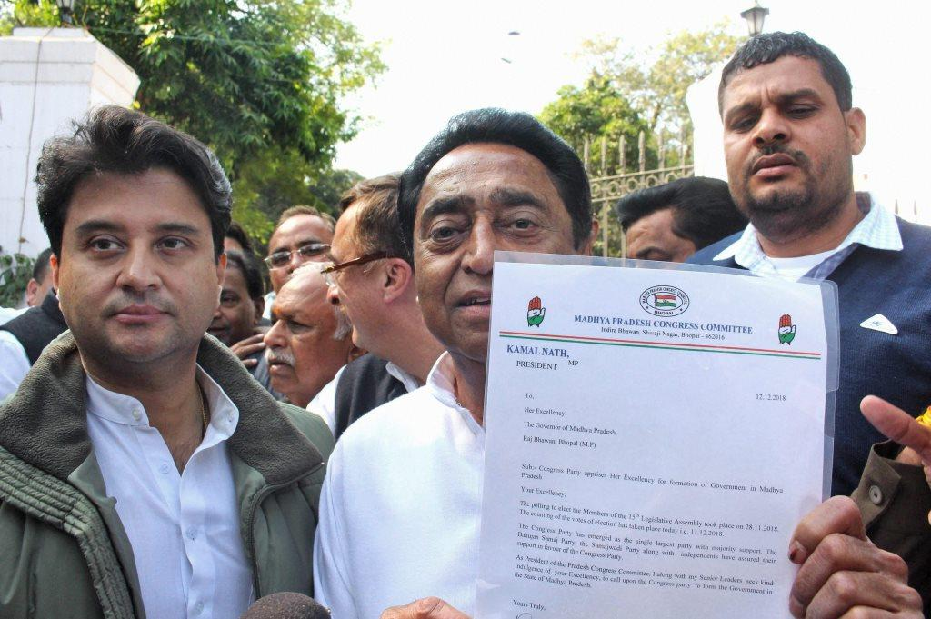 Bhopal: Congress State President Kamal Nath, party leader Jyotiraditya Scindia and other leaders leave after a meeting with Governor Anandiben Patel to stake claim to form the government at Raj Bhawan, in Bhopal, Wednesday, Dec. 12, 2018. (PTI Photo)