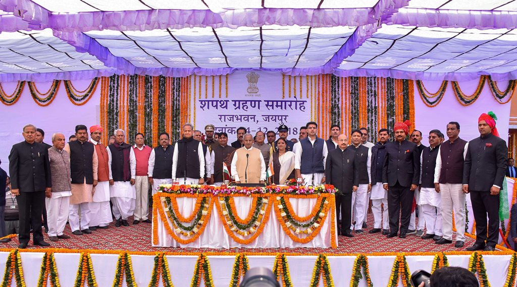 Jaipur: Rajasthan Governor Kalyan Singh, Chief Minister Ashok Gehlot, Deputy Chief Minister Sachin Pilot pose for a photograh with the newly sworn-in cabinet ministers during a ceremony at Raj Bhawan, in Jaipur, Monday, Dec. 24, 2018. (PTI Photo)(PTI12_24_2018_000041)