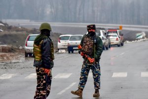Awantipora: Army soldiers stand guard near the site of suicide bomb attack at Lathepora Awantipora in Pulwama district of south Kashmir, Thursday, February 14, 2019. At least 30 CRPF jawans were killed and dozens other injured when a CRPF convoy was attacked. (PTI Photo/S Irfan)    (PTI2_14_2019_000155B)