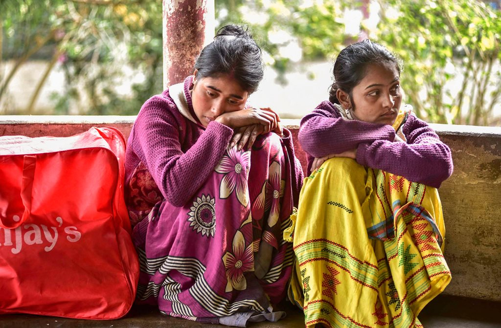 Golaghat: Relative of the victims, who died after consuming spurious liquor at a tea garden, wait at the hospital, in Golaghat, Saturday, Feb 23, 2019. At least 59 people died allegedly after the incident. (PTI Photo) (PTI2_23_2019_000121B)
