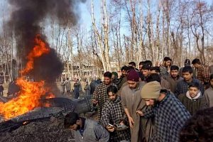 Budgam: People gather near the debris of IAF's MI-17V5 chopper that crashed in a village in Budgam, J & K, Wednesday, Feb 27, 2019. (PTI Photo)  (PTI2_27_2019_000028B)