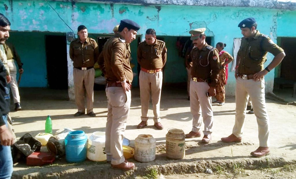 Haridwar :Policemen recoverd poisonous liquor in Balupur village on Saturday Feb,9,2019 . Several people died after consuming liquor. (PTI Photo ) (PTI2_9_2019_000129B)