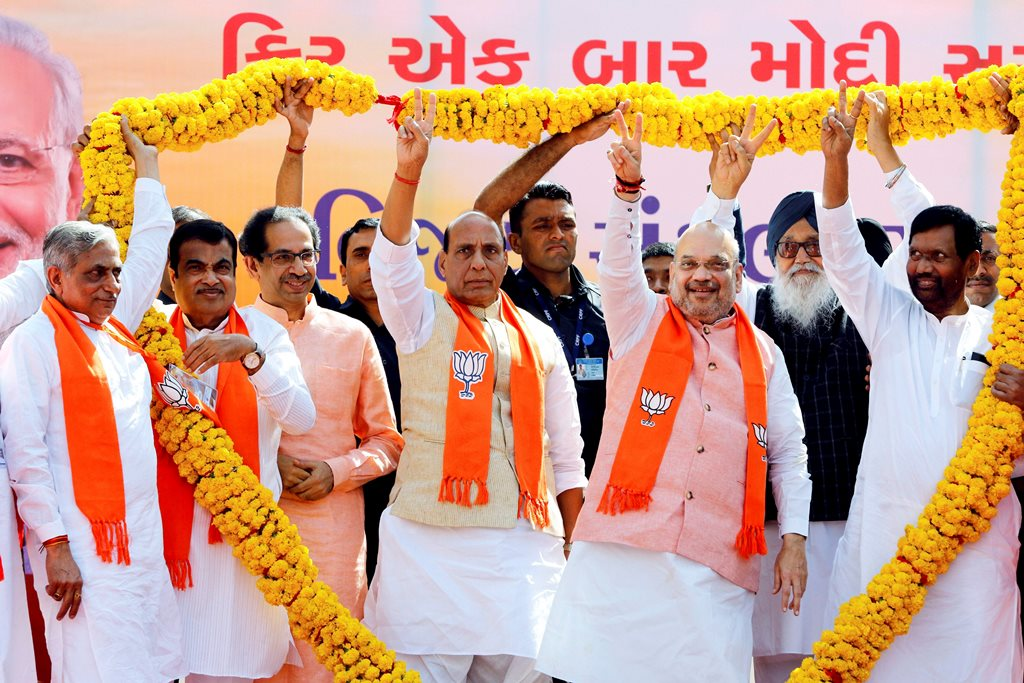 Ahmedabad: Bhartiya Janta Party supporters felicitate Union Home Minister Rajnath Singh, BJP National President Amit Shah, Union Minister Nitin Gadkari, Shiv Sena chief Uddhav Thackeray, former Punjab Chief Minister Parkash Singh Badal and others during 'Vijay Sankalp Sabha' ahead of Shah's nomination filing from the Gandhinagar constituency for the upcoming Lok Sabha elections, in Ahmedabad, Saturday, March 30, 2019. (PTI Photo)(PTI3_30_2019_000015B)