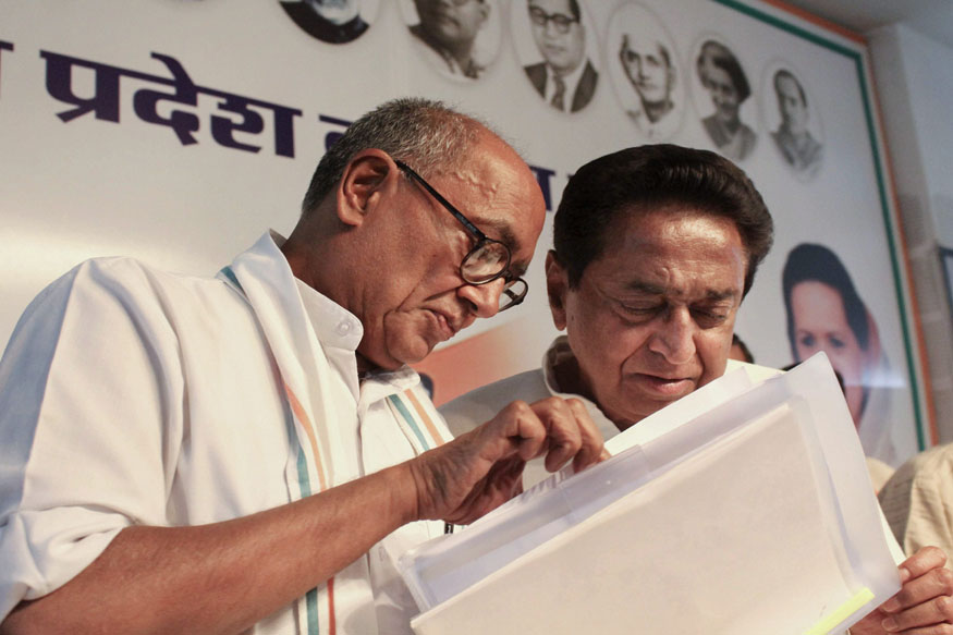 Bhopal: AICC General Secretary Digvijay Singh and Congress state President Kamal Nath at a joint press conference in Bhopal, on Thursday. (PTI Photo) (PTI5_24_2018_000101B)