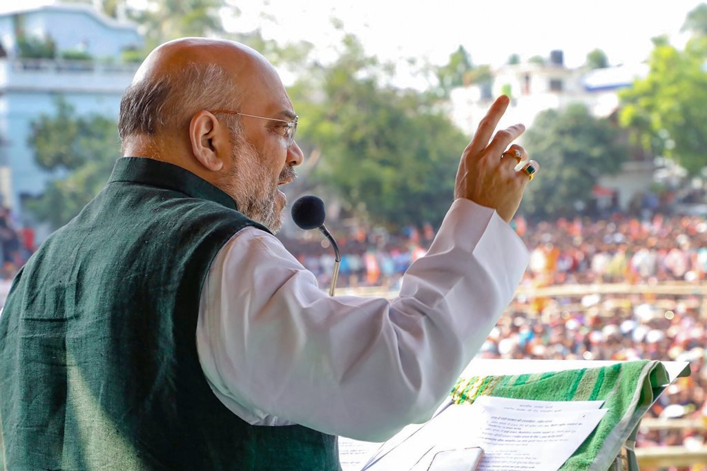 Raiganj: BJP National President Amit Shah addresses an election rally for Lok Sabha polls, in Raiganj, Uttar Pradesh, Thursday, April 11, 2019. (PTI Photo) (PTI4_11_2019_000243B)