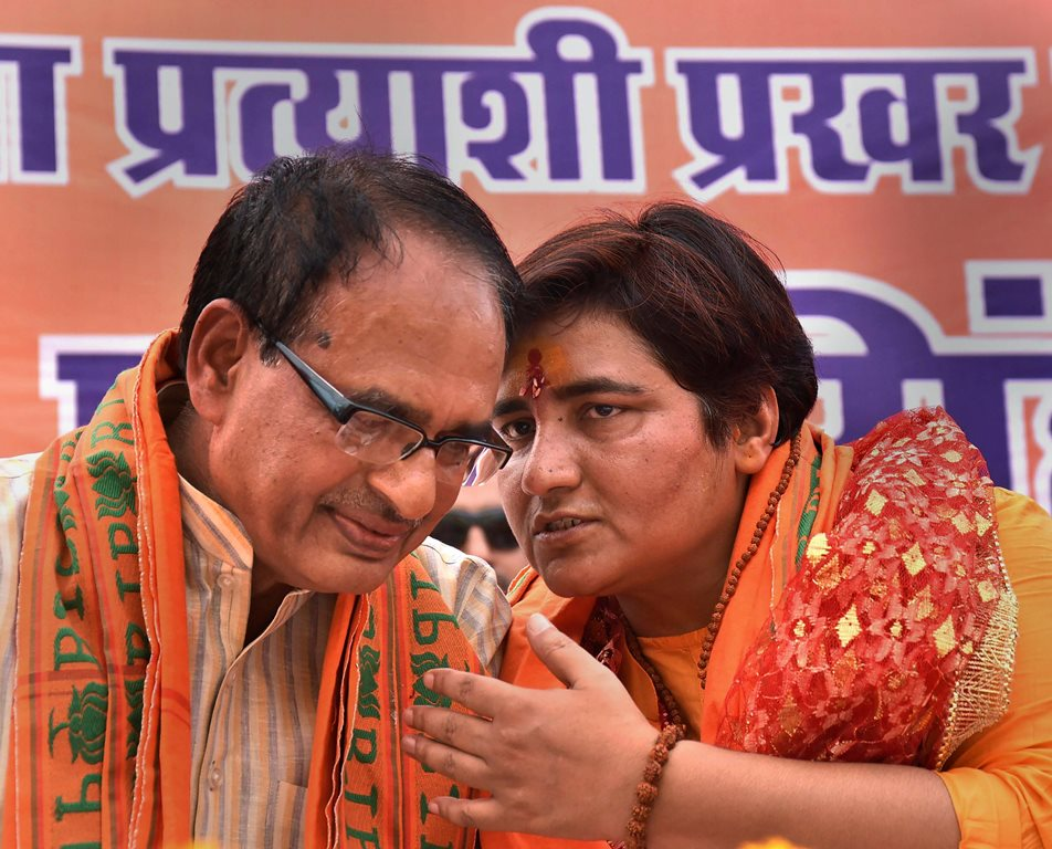 Bhopal: BJP candidate for Bhopal Lok Sabha constituency Sadhvi Pragya Singh Thakur with BJP National Vice President Shivraj Singh Chouhan before filing her nomination papers for Lok Sabha polls, in Bhopal, Tuesday, April 23, 2019. (PTI Photo) (PTI4_23_2019_000154B)