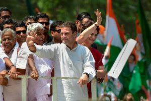 Wayanad: Congress President Rahul Gandhi along with party General Secretary and Uttar Pradesh - East in charge Priyanka Gandhi Vadra and other leaders wave at party supporters during a roadshow ahead of the former's nomination filing, ahead of the Lok Sabha elections, in Wayanad, Thursday, April 4, 2019. (PTI Photo/Shailendra Bhojak)(PTI4_4_2019_000065B)