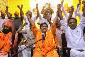 Bhopal: BJP candidate Sadhvi Pragya Singh Thakur gestures while addressing a party workers' meeting for Lok Sabha polls, in Bhopal, Thursday, April 18, 2019. (PTI Photo) (PTI4_18_2019_000258B)