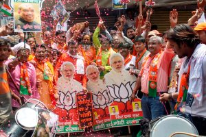 Varanasi: BJP workers celebrate party's lead in the Lok Sabha elections 2019, in Varanasi, Thursday, May 23, 2019. (PTI Photo) (PTI5_23_2019_000087B)