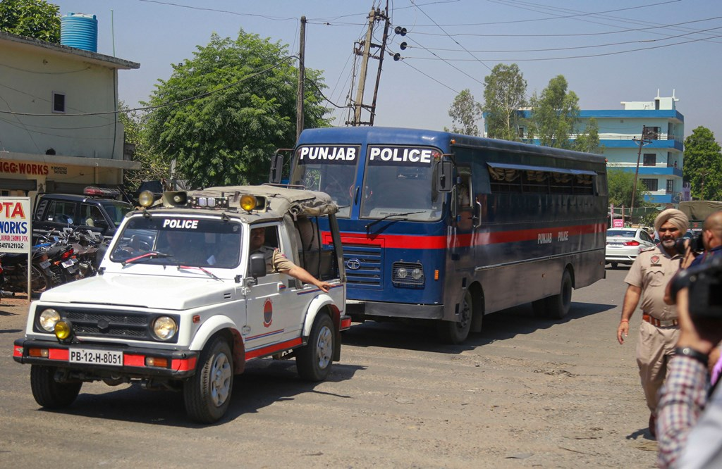 Pathankot: A police bus carrying all the accused involved in the rape and murder of a nomadic minor girl in Jammu and Kashmir's Kathua, arrives at the Judicial Courts Complex for the verdict, in Pathankot, Monday, June 10, 2019. (PTI Photo)(PTI6_10_2019_000034B)