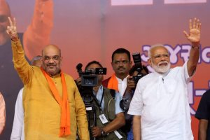 Ahmedabad: Prime Minister Narendra Modi with BJP President Amit Shah during a public meeting at the BJP office in Ahmedabad, Sunday, May 26, 2019, after the victory in the recent Lok Sabha elections. (PTI Photo) (PTI5_26_2019_000108B)
