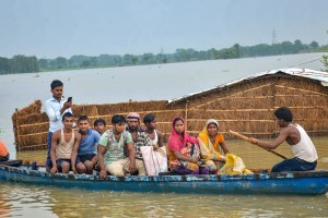 Muzaffarpur: Flood-affected villagers use a boat to take a patient to hospital from their inundated village, at Mithan Sharay in Muzaffarpur, Tuesday, July 23, 2019. (PTI Photo) (PTI7_23_2019_000233B)
