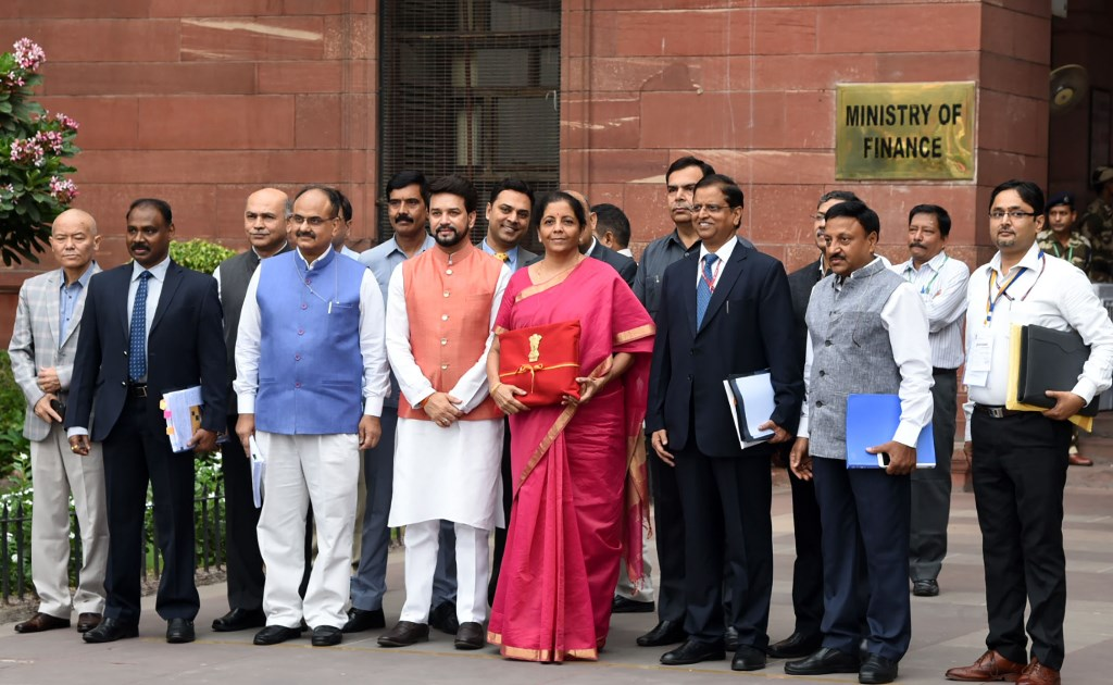The Union Minister for Finance and Corporate Affairs, Smt. Nirmala Sitharaman departs from North Block to Rashtrapati Bhavan and Parliament House, along with the Minister of State for Finance and Corporate Affairs, Shri Anurag Singh Thakur and the senior officials to present the General Budget 2019-20, in New Delhi on July 05, 2019. PIB Photo