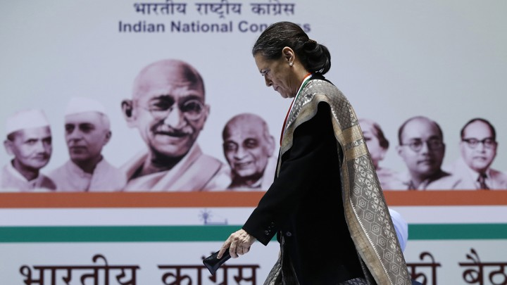 Sonia Gandhi, Chief of India's ruling Congress party, walks to address her party workers at the All India Congress Committee (AICC) meeting in New Delhi January 17, 2014. REUTERS/Adnan Abidi (INDIA - Tags: POLITICS) - GM1EA1H1OUK01