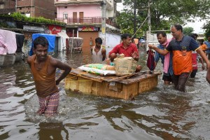 Patna: Locals transport their belongings on a makeshift boat to a safer place from flood-affected Bahadurpur area following heavy monsoon rainfall, in Patna, Tuesday, Oct. 01, 2019. (PTI Photo) (PTI10_1_2019_000069B)