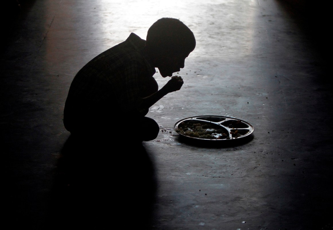A boy eats at an orphanage run by a non-governmental organisation on World Hunger Day, in the southern Indian city of Chennai May 28, 2014. REUTERS/Babu