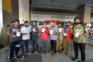 New Delhi: Indian nationals who did not have a condition of regular stay in Mexico show their passports at Indira Gandhi International Airport after being deported, in New Delhi, Friday, Oct. 18, 2019. Mexico's migration authorities deported 311 Indians, including a woman, from various parts of the country amidst its stepped up efforts to check people illegally crossing its borders following pressure from the US. (PTI Photo/Vijay Verma)(PTI10_18_2019_000088B)