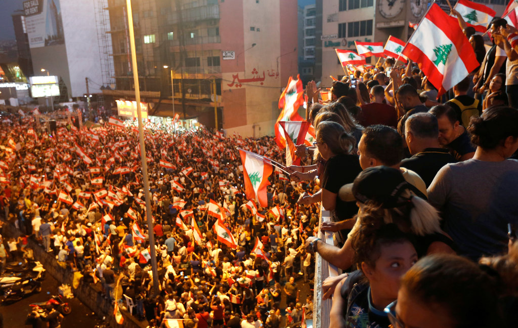 Demonstrators on Monday in Jal al Dib, a suburb of the Lebanese capital, Beirut. The country has united in protest, if nothing else. (Credit: Mohamed Azakir/Reuters)