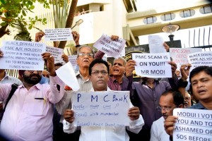 Mumbai: Depositors of  Punjab and Maharashtra Cooperative (PMC) bank display placards during a protest over the bank's crisis, outside the Reserve Bank of India building, in Mumbai, Tuesday, Oct 1, 2019. (PTI Photo)   (PTI10_1_2019_000126B)