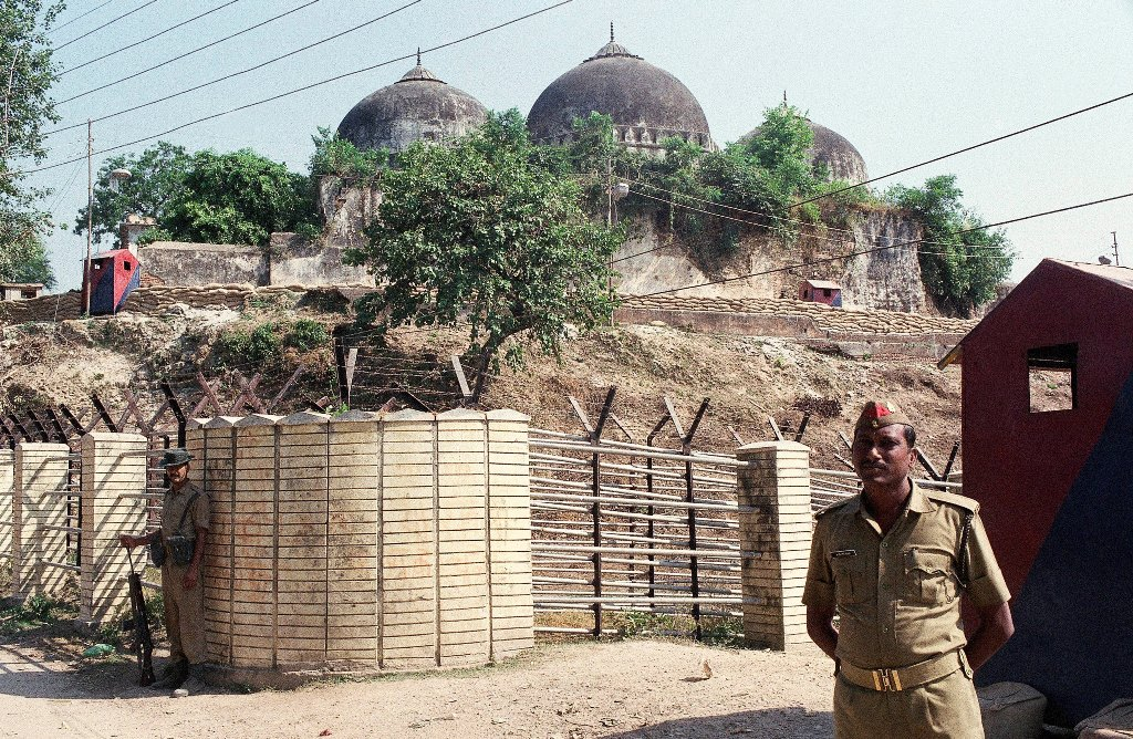 Ayodhya: FILE - In this Oct. 29, 1990, file photo, Indian security officer guards the Babri Mosque in Ayodhya, closing off the disputed site claimed by Muslims and Hindus. India's top court is expected to pronounce its verdict on Saturday, Nov. 9, 2019, in the decades-old land title dispute between Muslims and Hindus over plans to build a Hindu temple on a site in northern India. In 1992, Hindu hard-liners demolished a 16th century mosque in Ayodhya, sparking deadly religious riots in which about 2,000 people, most of them Muslims, were killed across India. AP/PTI(AP11_9_2019_000012B)
