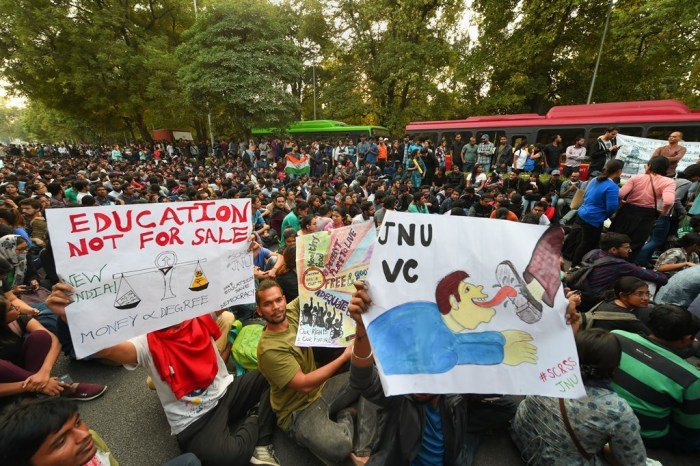 New Delhi: Jawaharlal Nehru University students block a road as they protest demanding a total roll back of the hostel fee hike, in New Delhi, Monday, Nov. 18, 2019. The students, who were holding a protest on the university's premises for the last three weeks, hit the streets seeking to get the attention of Parliament about their demands, asserting they will not relent until the government withdraws the hike. (PTI Photo/Shahbaz Khan)(PTI11_18_2019_000275B)