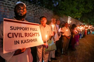 Ahmedabad: Social activists hold a placard and candles during a silent protest against government on Kashmir issue, in Ahmedabad, Thursday, Oct. 17, 2019. (PTI Photo)(PTI10_17_2019_000172B)