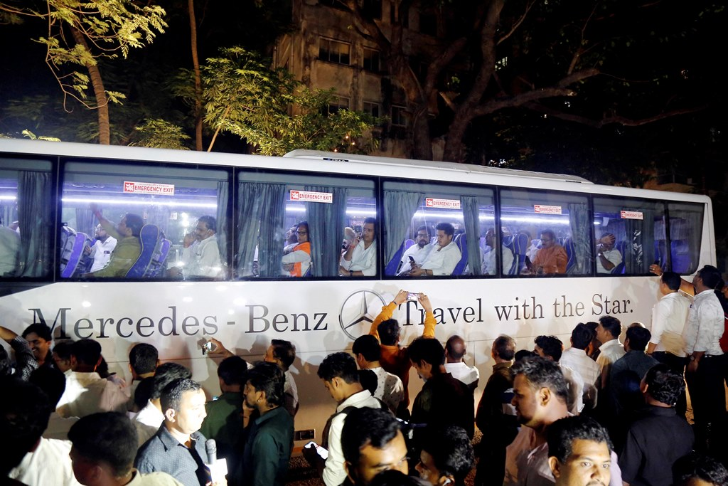 Mumbai: NCP MLAs leave in a bus after a meeting with party MLA's in Mumbai, Saturday, Nov. 23, 2019. At least nine NCP MLAs who attended swearing-in of Ajit Pawar as deputy chief minister of Maharashtra returned to the party fold and expressed solidarity with party chief Sharad Pawar. (PTI Photo)(PTI11_23_2019_000284B)