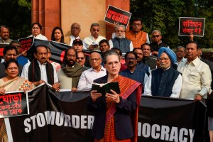New Delhi: Congress President Sonia Gandhi reads out the Preamble to the Constitution as party leaders Manmohan Singh, Rahul Gandhi and other opposition leaders look on during a protest, at Parliament premises in New Delhi, Tuesday, Nov. 26, 2019. (PTI Photo/Kamal Singh) (PTI11_26_2019_000085B)