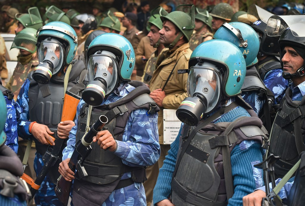 New Delhi: Security personnel with anti-teargas masks standby during protests against the Citizenship (Amendment) Act after Friday prayers, at Darya Ganj in New Delhi, Friday, Dec. 20, 2019. (PTI Photo/Kamal Kishore)(PTI12_20_2019_000069B)