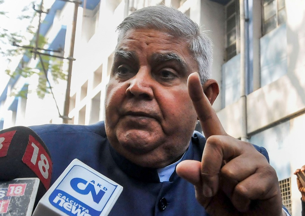Kolkata: West Bengal Governor Jagdeep Dhankhar gestures as he speaks to the media persons after his motorcade was stopped by protesters at a gate of Jadavpur University, as he arrived to attend its annual convocation, in Kolkata, Tuesday, Dec. 24, 2019. (PTI Photo)(PTI12_24_2019_000079B)