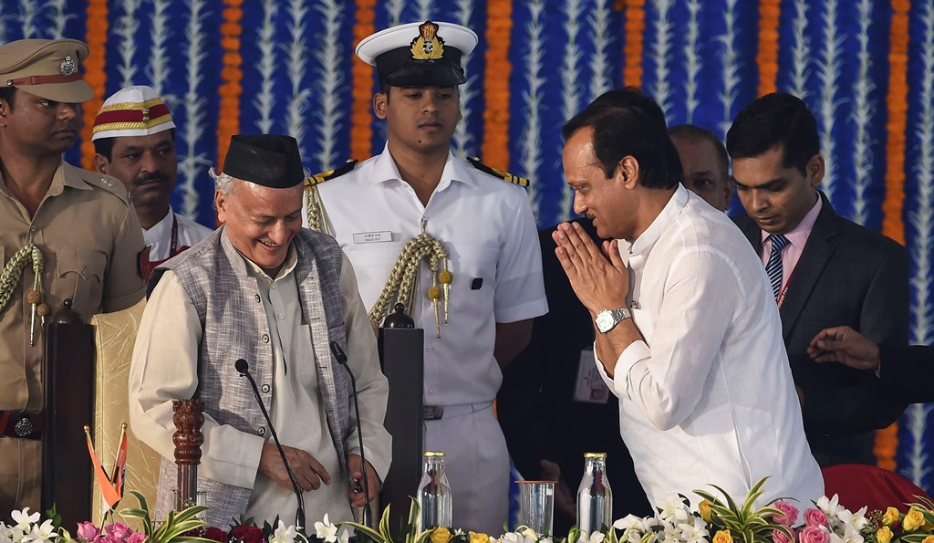 Mumbai: NCP leader Ajit Pawar greets Maharashtra governor Bhagat Singh Koshyari during the swearing in ceremony for State cabinet expansion at Vidhan Bhavan in Mumbai, Monday, Dec. 30, 2019. Pawar took oath as the Deputy of Maharashtra Chief Minister Uddhav Thackeray today. (PTI Photo/Mitesh Bhuvad)(PTI12_30_2019_000097B)