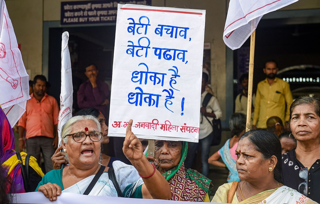 Mumbai: Women activists disply placards and shout slogans during a protest against the Hyderabad rape and murder case, at Dadar in Mumbai, Tuesday, Dec. 3, 2019. (PTI Photo/Mitesh Bhuvad) (PTI12_3_2019_000172B)