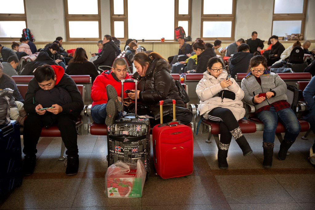 Beijing: Travelers sit in waiting room at the Beijing Railway Station in Beijing, Friday, Jan. 17, 2020. As the Lunar New Year approached, Chinese travelers flocked to train stations and airports Friday to take part in a nationwide ritual: the world's biggest annual human migration. AP/PTI(AP1_17_2020_000034B)