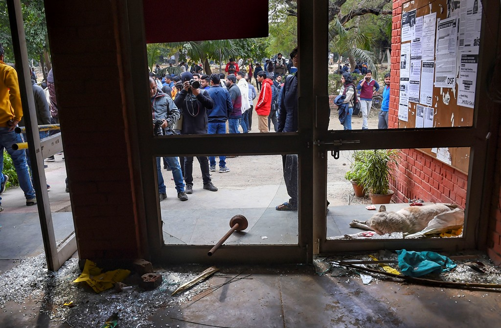 New Delhi: Shattered glass of doors are seen at the Sabarmati Hostel following the Sundays violence at the Jawaharlal Nehru University (JNU) , in New Delhi, Monday, Jan. 6, 2020. A group of masked men and women armed with sticks, rods and acid allegedly unleashed violence on the campus of the University, Sunday evening. (PTI Photo/Atul Yadav) (PTI1 6 2020 000072B)