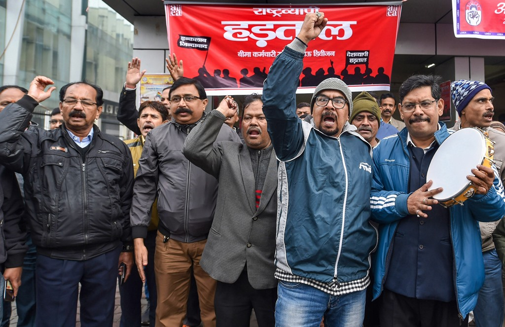Lucknow: Members of various unions demonstrate outside the LIC Building in Hazratganj during the trade unions' nationwide strike, in Lucknow, Wednessday, Jan. 8, 2020. (PTI Photo/Nand Kumar) (PTI1_8_2020_000087B)